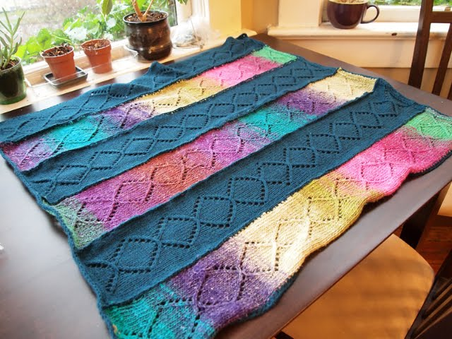 A spectacular baby blanket made with Berroco Vintage DK and Noro Silk Garden Sock. Wow!